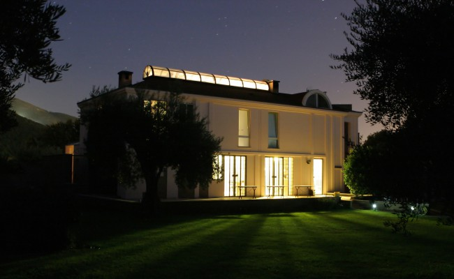 Modern illuminated house in the dark